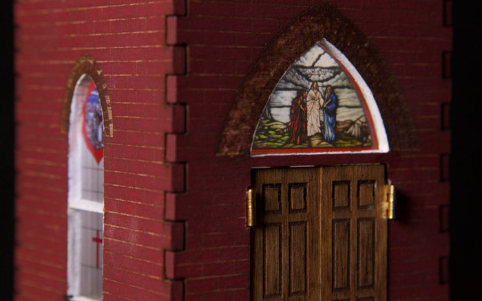 Closeup of stained glass windows in steeple replica
